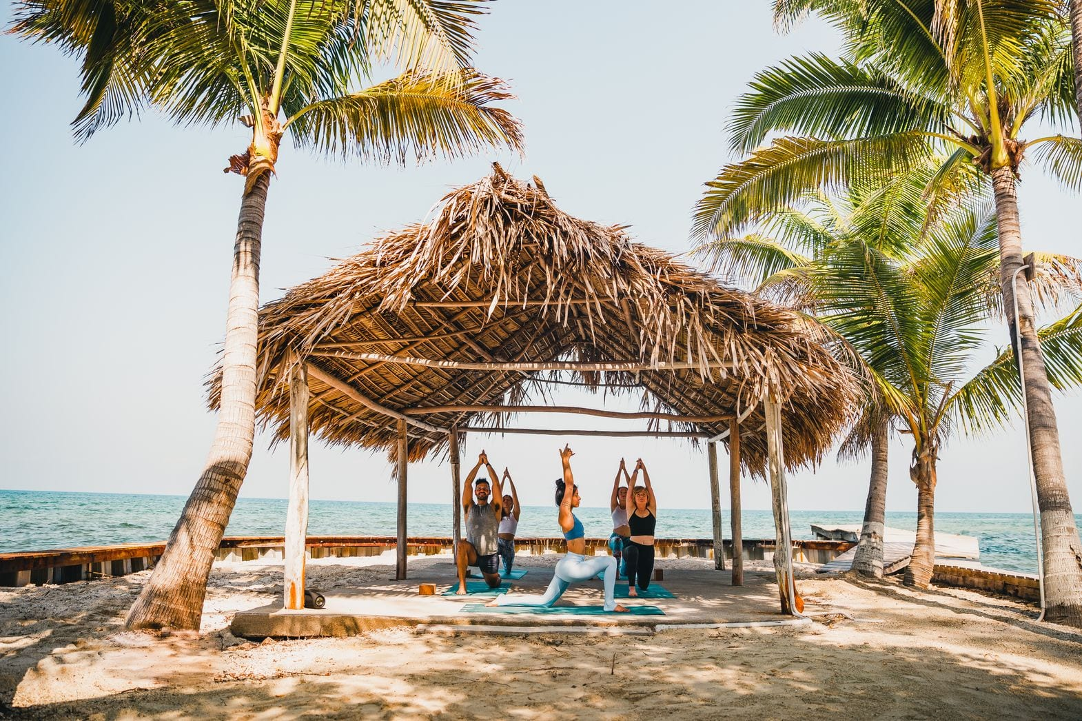 thatch caye yoga wellness belize island muyono