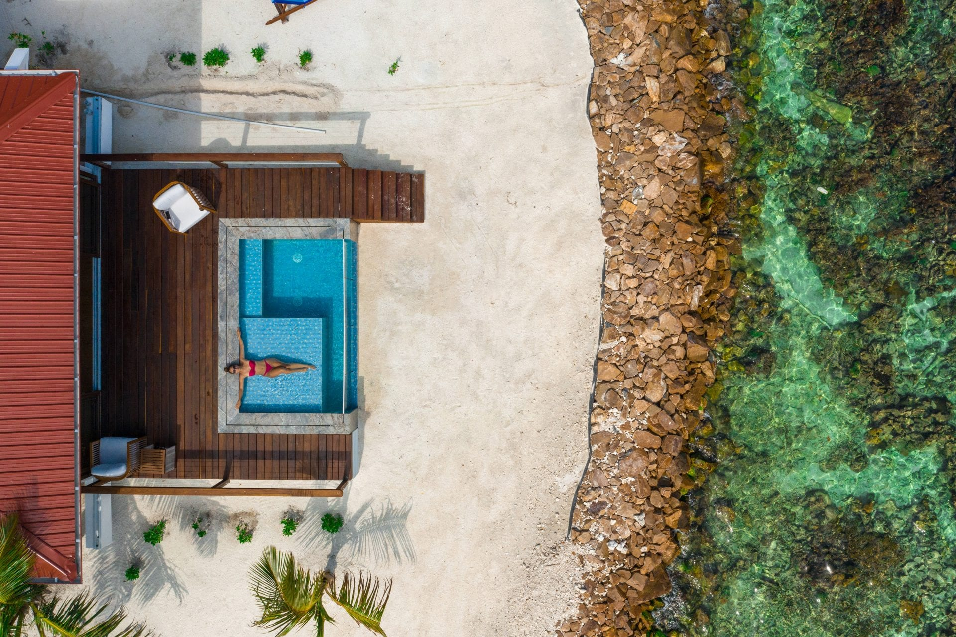 Privacy and plunge pools at Ray Caye Island Resort in Belize aerial