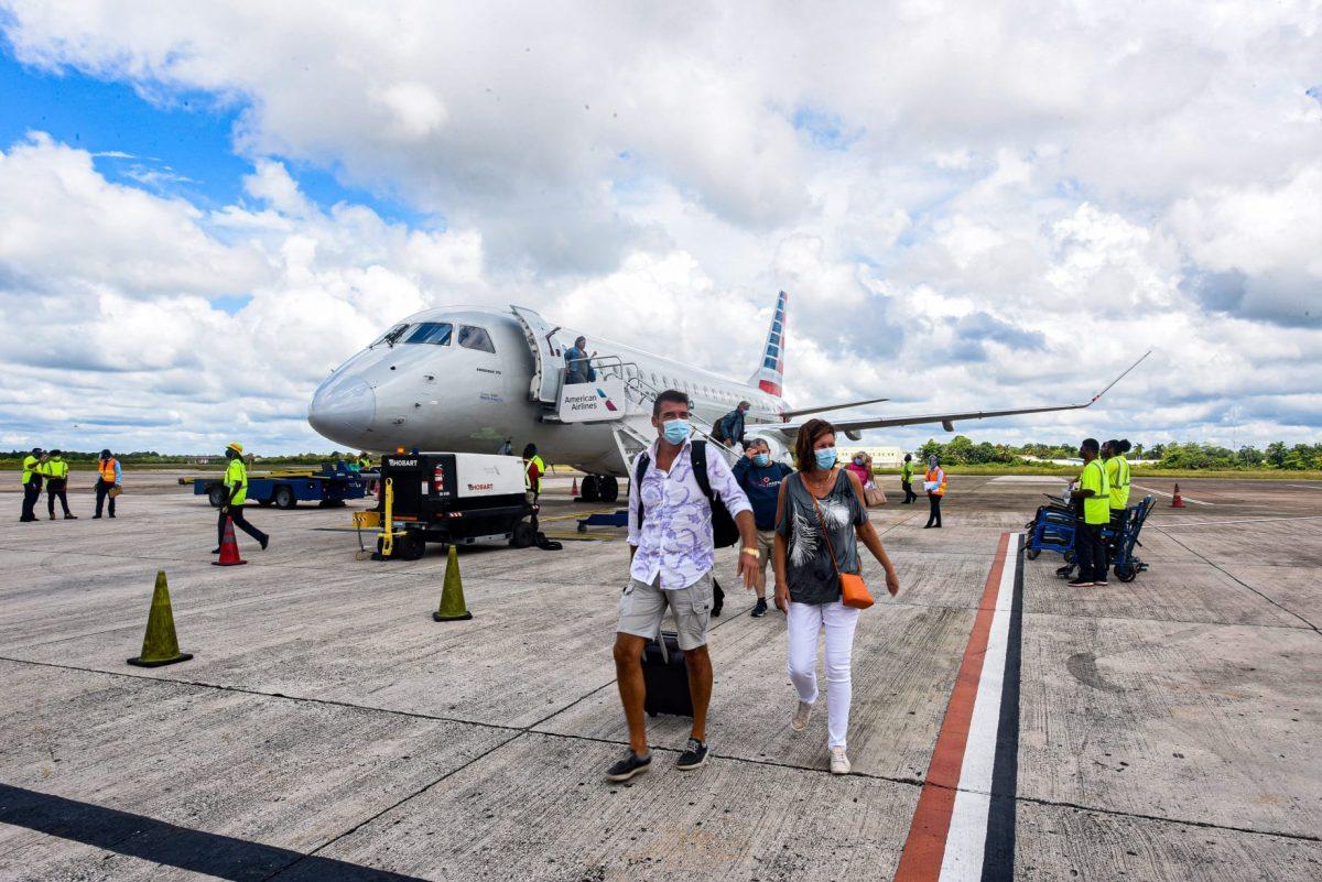 AA flight arrive belize airport tarmac covid