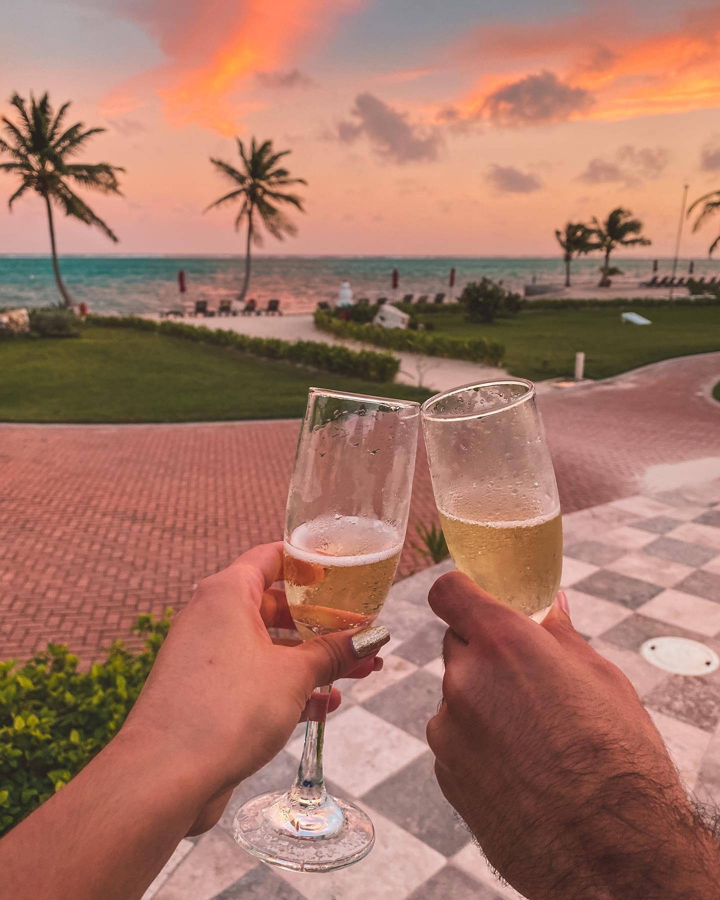 grand caribe couple cheers champagne