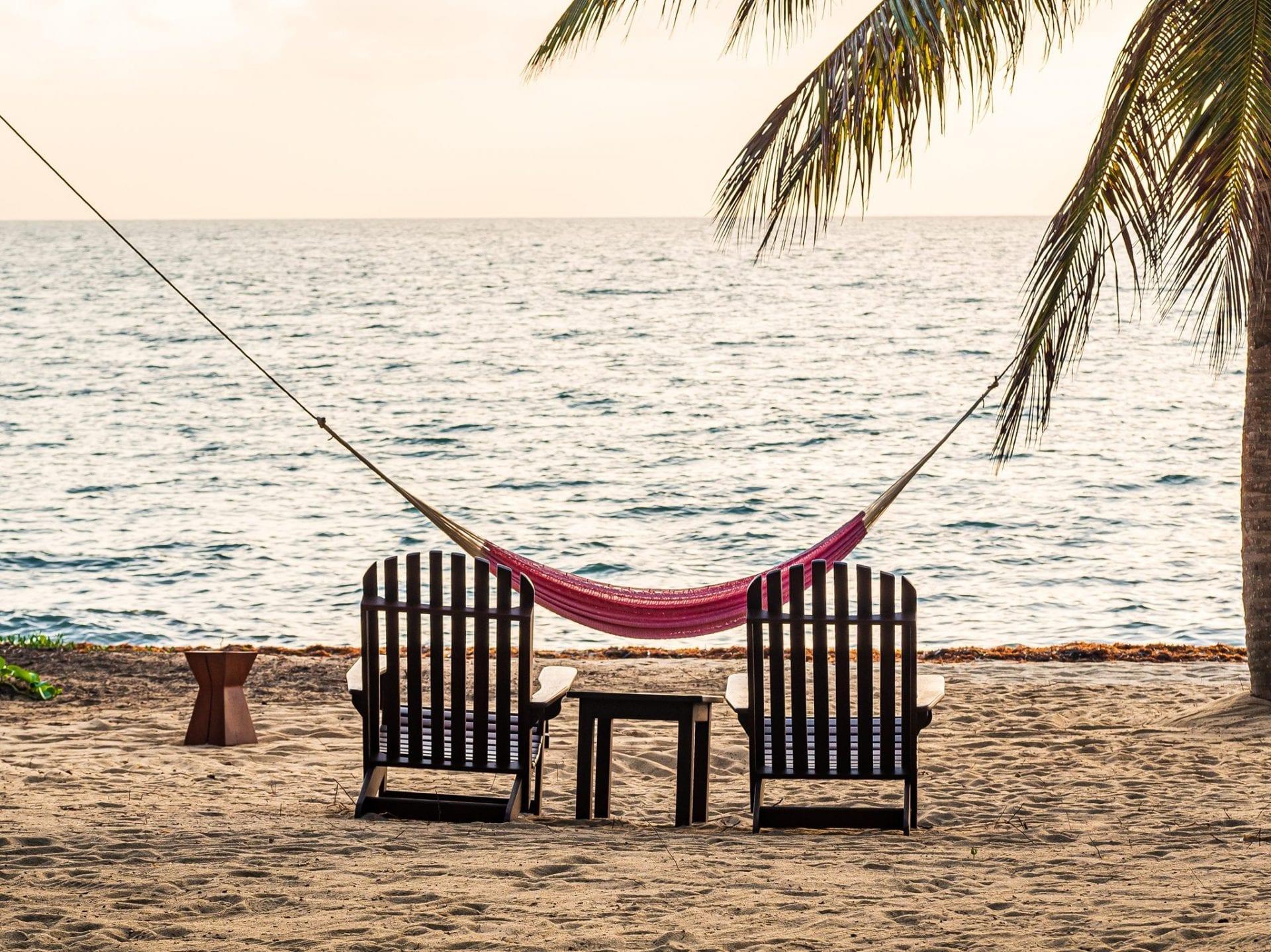 two beach chairs and hammock Hopkins beach Hamanasi