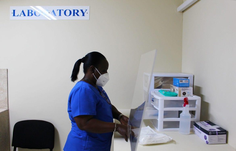 caring hands clinic Belize City tza Maya island air covid test laboratory