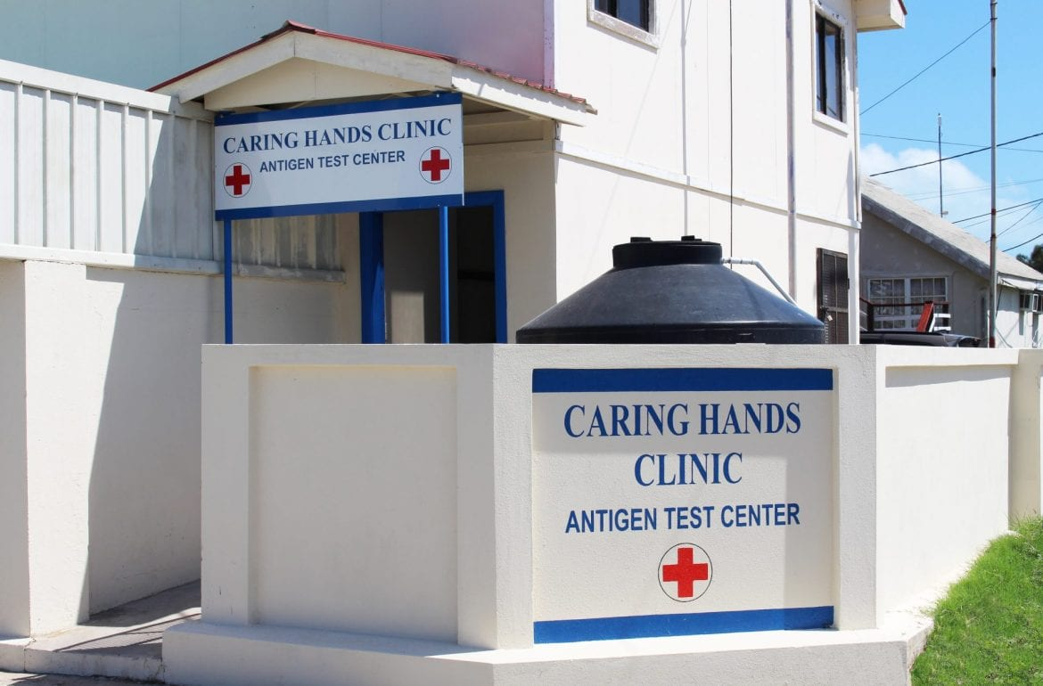 caring hands clinic Belize City tza Maya island air covid test exterior