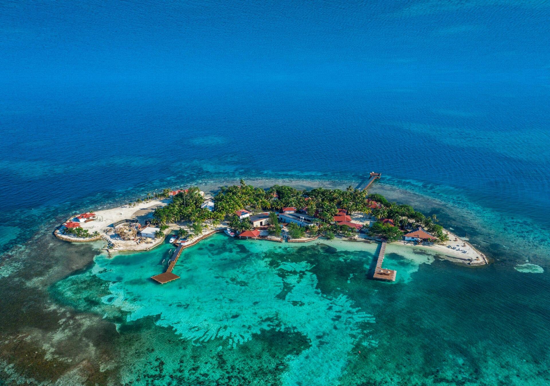 Ray Caye aerial drone Duarte Dellarole island resort belize side view