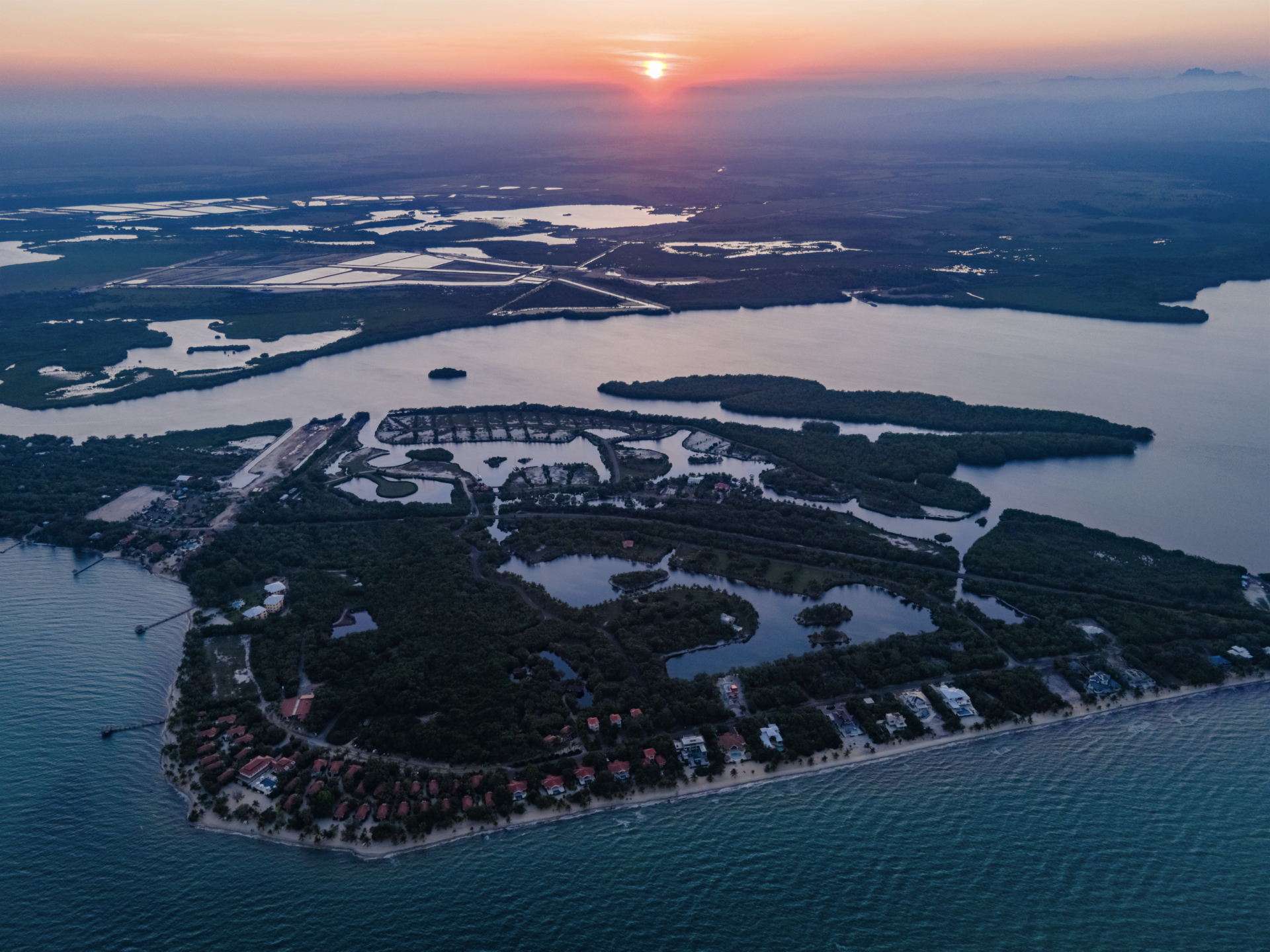 naia-resort-spa-placencia-belize-sunset-aerial