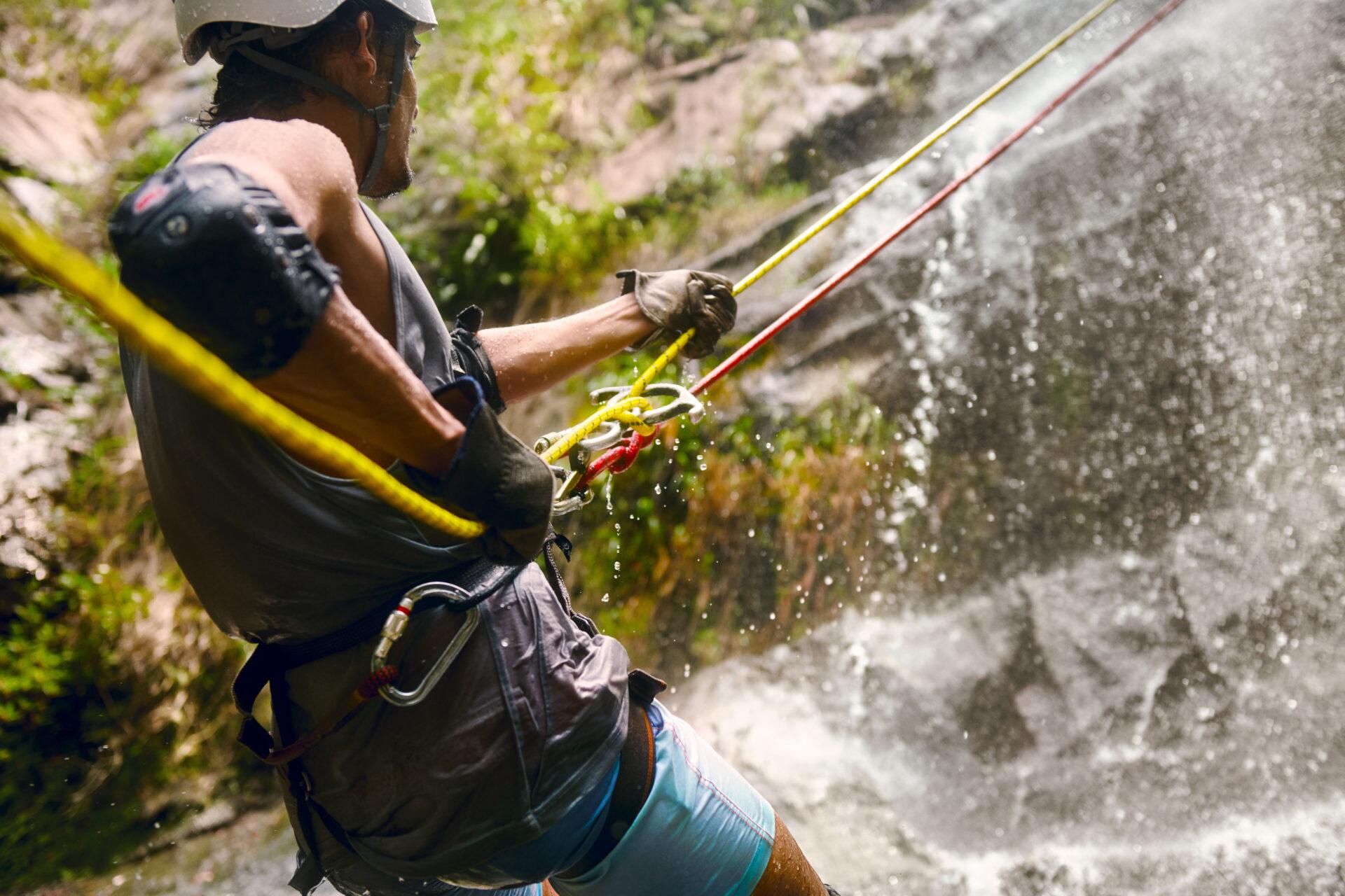 rapel rock face waterfall belize adventure travel